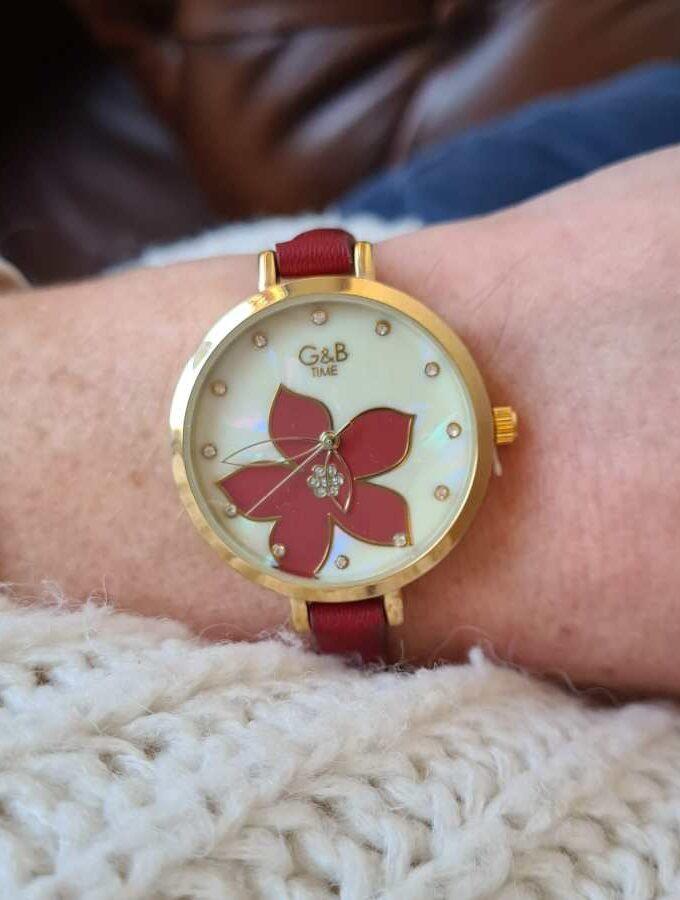 horloge rood met bloem