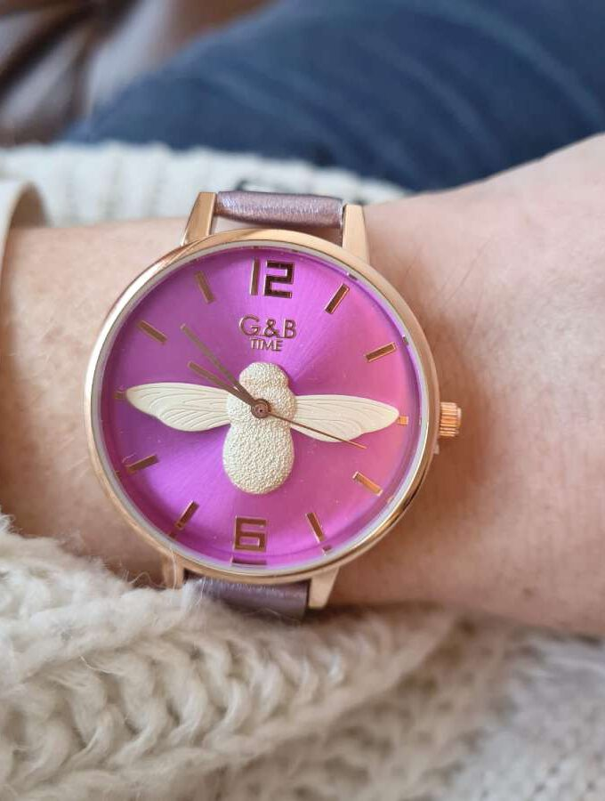 paars horloge vlieg