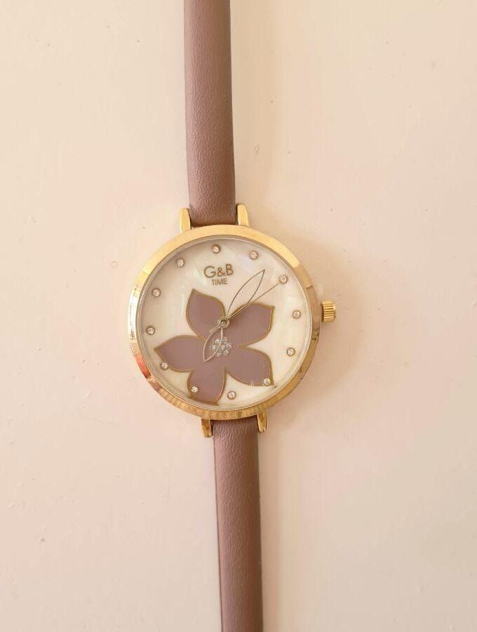 taupe horloge bloem