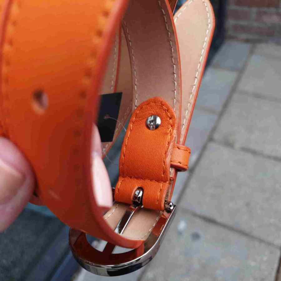 Leren riem 25mm zilveren gesp in oranje schroef