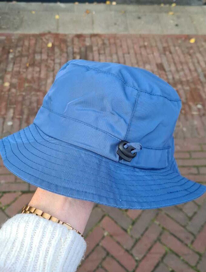 Blauw regenhoedje dames verstelbaar