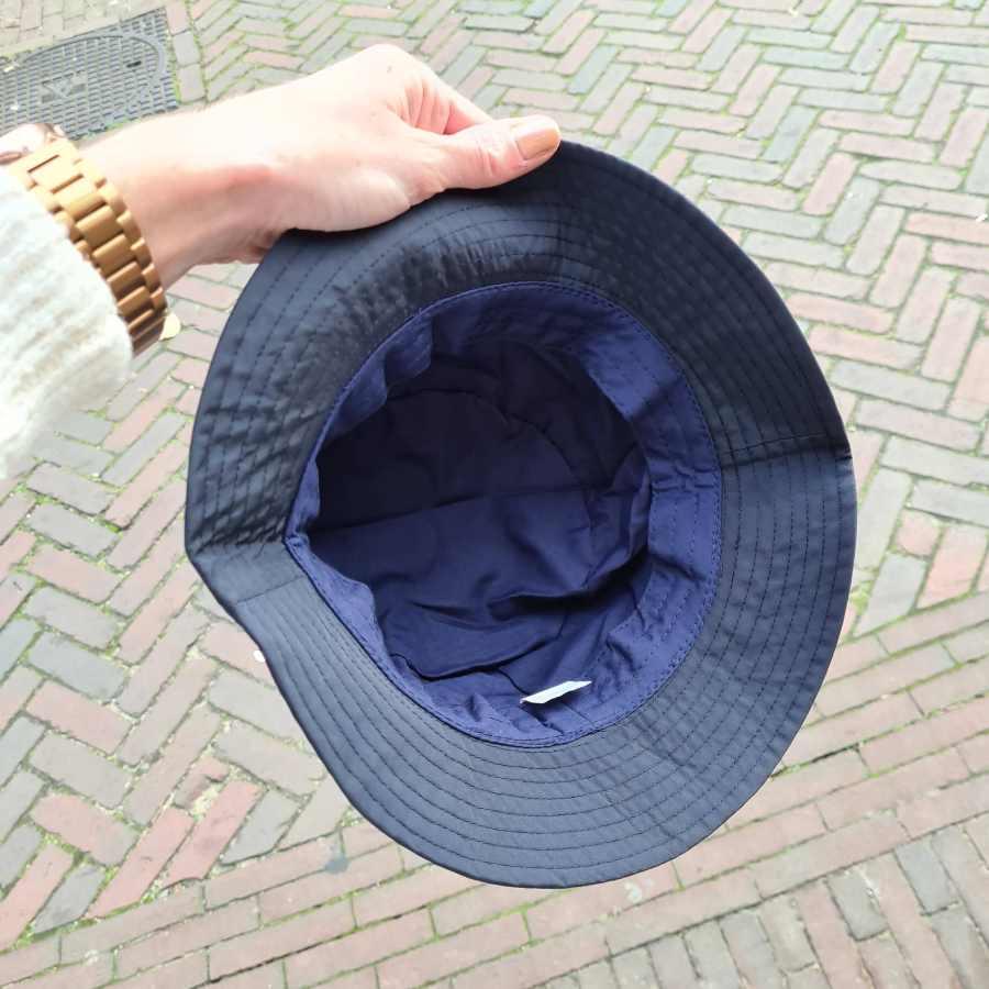 Regenhoed dames blauw met touwtje