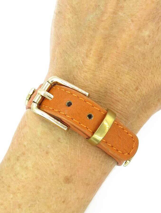 Oranje armband met gouden sterren