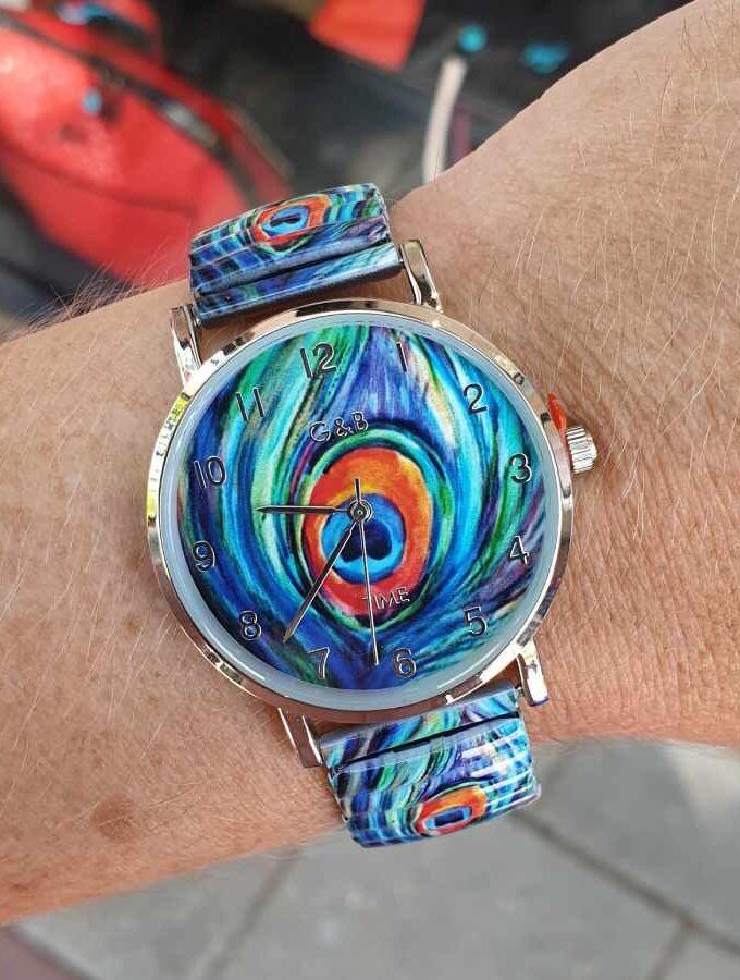 Horloge pauwenogen blauw groen