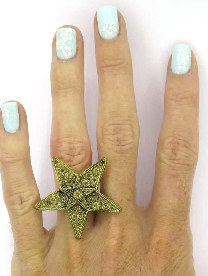 Ring ster goudkleurig stenen